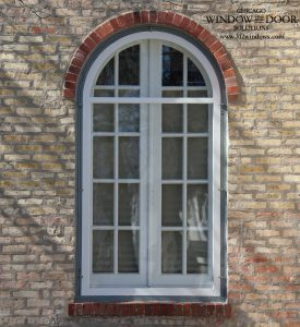 round top window with storm panel