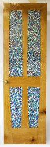 Custom wood door with inlaid marbles