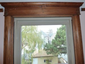 Mismatched vinyl window in wood opening
